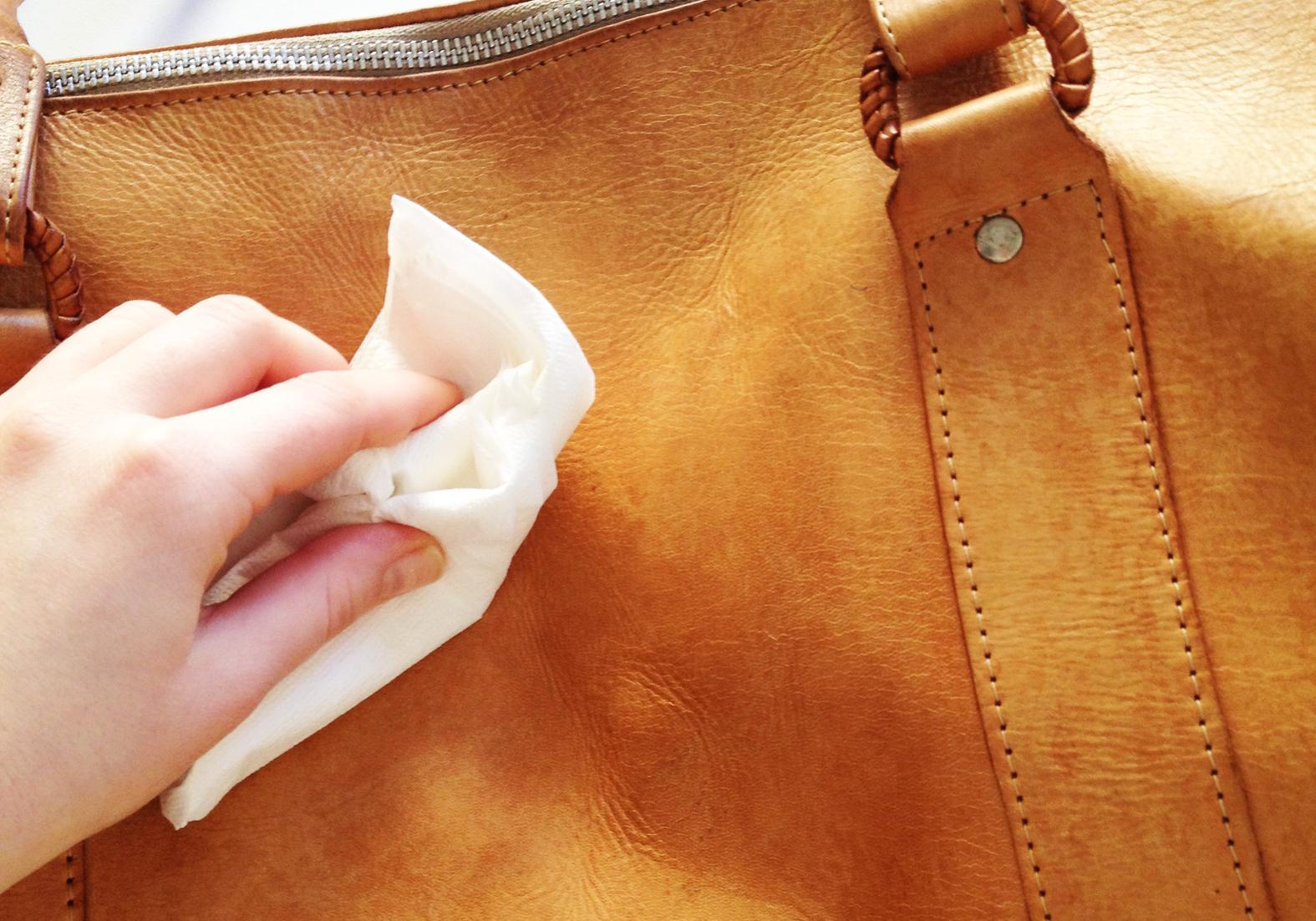 Как удалить пятно с сумки от черной одежды фото
